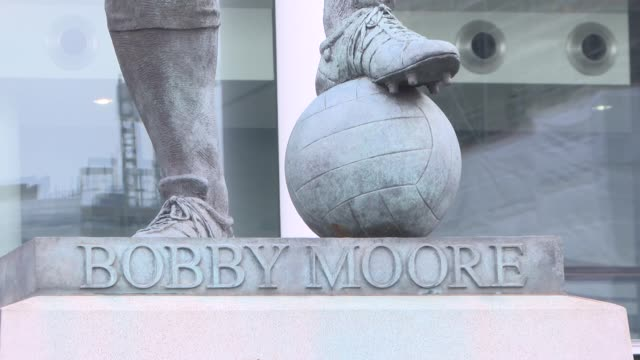 'the bromley boys' premiere red carpet interviews england london wembley wembley stadium ext 'the bromley boys' logo / bobby moore statue / wembley... - statue stock videos & royalty-free footage