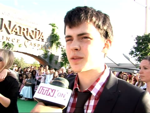 film 'the chronicles of narnia prince caspian' gvs of premiere and interviews skandar keynes interview sot on the premiere on ben joining cast on... - will.i.am stock videos & royalty-free footage