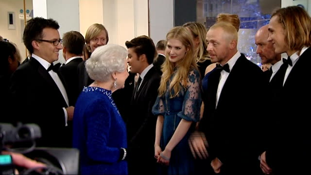 """the chronicles of narnia: the voyage of the dawn treader"" has royal premiere in london: queen arrives; queen being introduced to cast members... - フラワーアレンジメント点の映像素材/bロール"