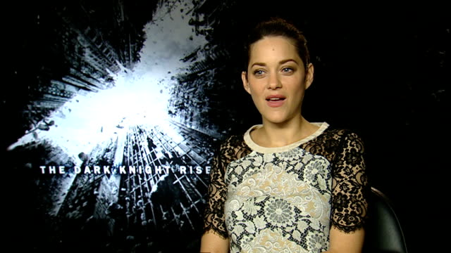 'the dark knight rises' cast interviews england london int marion cotillard interview sot on finally being able to answer questions about the film... - an answer film title stock videos & royalty-free footage