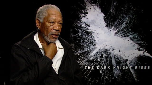 'the dark knight rises' cast interviews morgan freeman interview sot on joking about it being a british film on never thinking twice about reprising... - morgan freeman stock videos & royalty-free footage