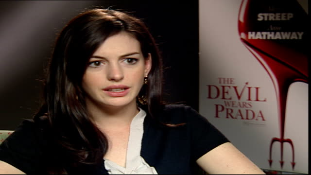 'the devil wears prada': anne hathaway interview; reporter asking question sot hathaway interview sot - on being compared to julia roberts - julia roberts stock videos & royalty-free footage