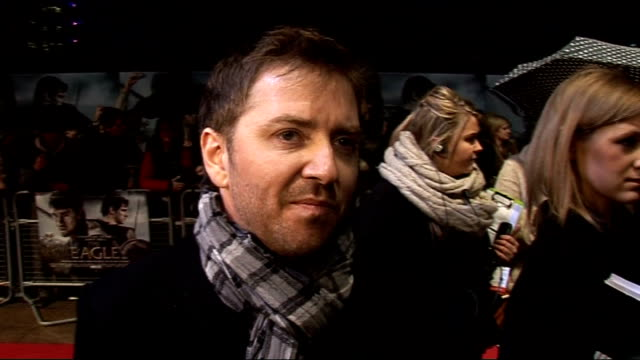 vídeos de stock, filmes e b-roll de 'the eagle' premiere celebrity arrivals atli orvarsson interview sot on trying to capture the era in the music / on being a composer like jack black... - o amor não tira férias título de filme