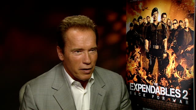 'The Expendables 2' Cast interviews Arnold Schwarzenegger interview SOT On challenges on set / offset action / whether he would remake one of his...