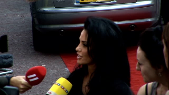 'the expendables' london premiere; katie price along on red carpet / katie price talking to press / katie price interview sot / - shaky stock videos & royalty-free footage