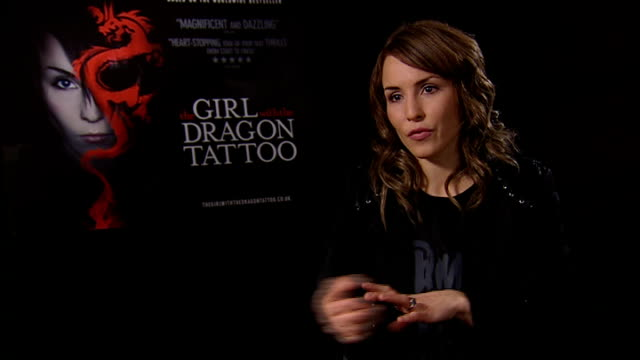 'the girl with the dragon tattoo': noomi rapace interview; noomi rapace interview continues sot - on similarities between herself and lisbeth /... - tattoo stock videos & royalty-free footage