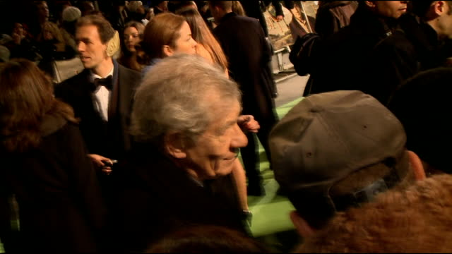 an unexpected journey' london film premiere; sir ian mckellen interview sot and general views / sylvester mccoy / dominic monaghan signing autographs... - スティーブン フライ点の映像素材/bロール