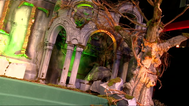 the battle of the five armies: uk film premiere; england: london: ext hobbit scenery for film premiere with film screens / crowd behind barriers... - the hobbit: the battle of the five armies stock videos & royalty-free footage