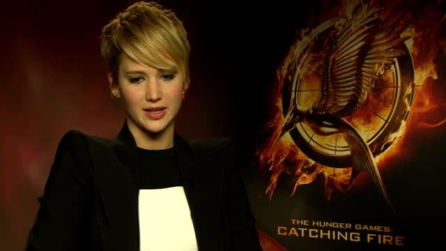 Jennifer lawrenceb getty images the hunger games catching fire interviews england london int jennifer lawrence interview sot voltagebd Image collections