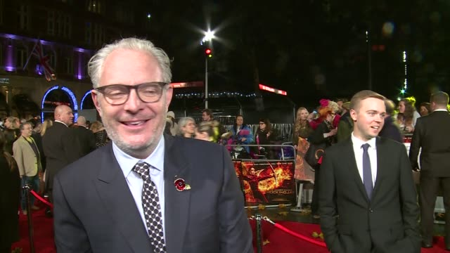 'the hunger games mockingjay part 2' red carpet arrivals francis lawrence interview sot / gvs natalie dormer / gvs tom daley / gvs julianne moore /... - effie stock videos and b-roll footage