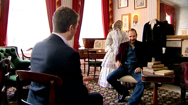 the invisible woman; england: london: charles dickens museum: int ralph fiennes set up shot with reporter / interview sot - レイフ・ファインズ点の映像素材/bロール