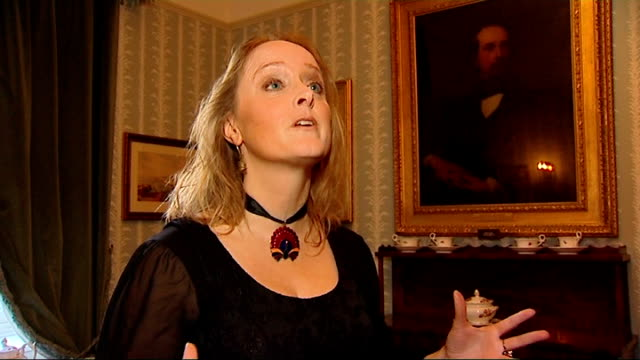 'the invisible woman' ralph fiennes interview / charles dickens museum lucinda hawksley interview sot hawksley looking at portraits on wall / more... - charles dickens stock videos & royalty-free footage