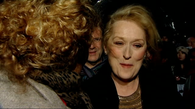 'the iron lady' premiere red carpet arrivals and interviews side view meryl streep and broadbent speaking with different reporters / back view streep... - 伝記映画点の映像素材/bロール
