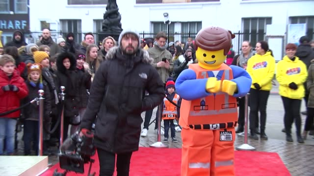 'the lego movie 2' popup cafe and interviews england london southwark south bank gvs lego cafe / man in lego costume on red carpet / chris pratt and... - chris pratt actor stock videos and b-roll footage