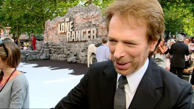 'The Lone Ranger' film premiere Red carpet arrivals and interviews GV Jerry Bruckheimer / Jerry Bruckheimer inrterview SOT / GVs Johnny Depp signing...
