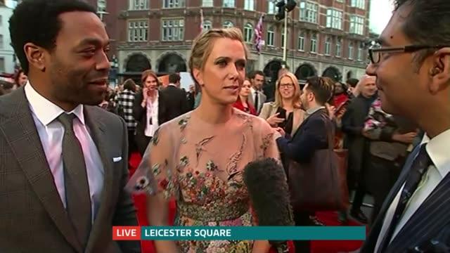 vídeos de stock, filmes e b-roll de 'the martian' premiere in london kristen wiig interview sot on being in london / jokes about being linked to role of james bond - kristen wiig