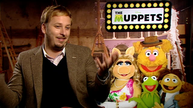 'the muppets' kermit the frog miss piggy and james bobin interviews james bobin interview sot on being a huge fan of the muppets / handling the... - slapstick stock videos & royalty-free footage