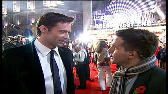premiere in london; jackman interview sot - on enjoying working with scarlett johansson / learning magic tricks / jokingly demonstrates a 'magic... - paul daniels stock videos & royalty-free footage