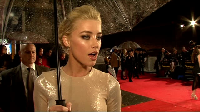 'The Rum Diary' premiere red carpet arrivals Amber Heard interview SOT On working with Johnny Depp / whether she drank rum / has a lot of guilty...