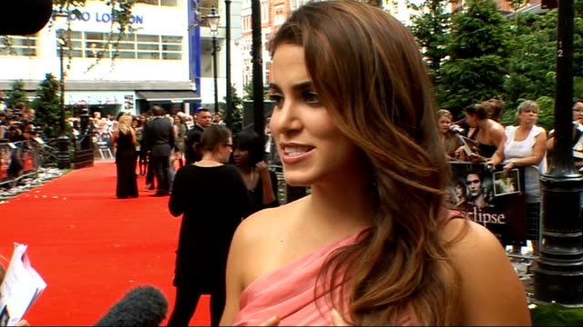 'the twilight saga eclipse' london premiere nikki reed red carpet interview sot/ nikki reed signing autographs brief - nikki reed stock videos and b-roll footage