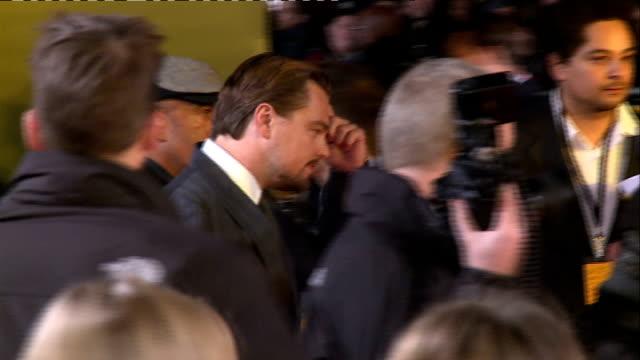 'The Wolf of Wall Street' premiere Leonardo DiCaprio posing / DiCaprio and Robbie posing / DiCaprio posing / back view DiCaprio Robbie and Hill...