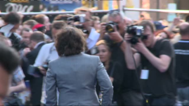 'the world's end' premiere interviews england london leicester square ext **music heard sot** photography** back views of edgar wright simon pegg and... - rosamund pike stock videos & royalty-free footage