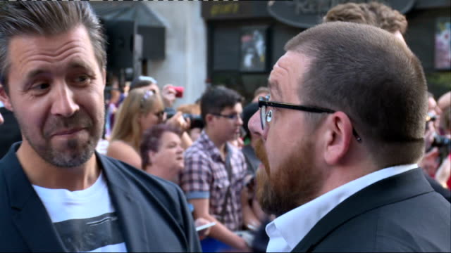 'the world's end' premiere interviews; pike chatting to press / frost chatting to press / frost and considine chatting to press / pike chatting to... - the world's end stock videos & royalty-free footage