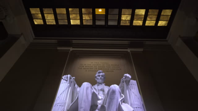 film tilt: abraham lincoln statue in lincoln memorial building in washington, dc usa - us president stock videos & royalty-free footage