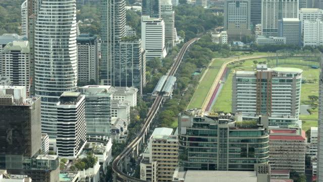 film tilt: aerial bangkok downtown skyline city life background - crane shot stock videos & royalty-free footage