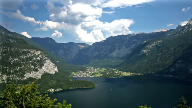 film tilt: aerial view of hallstatt village and lake, austria - traditionally austrian stock videos & royalty-free footage