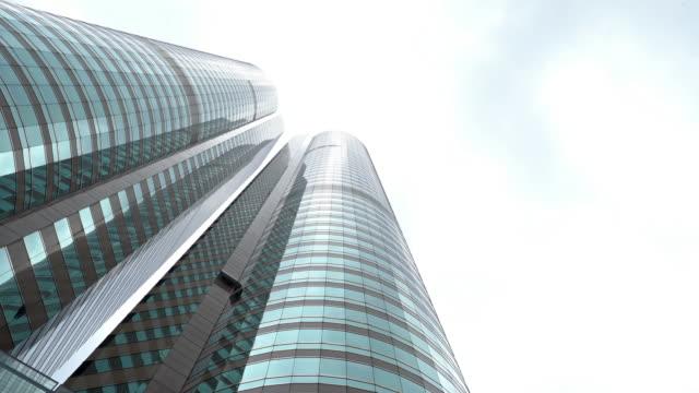 film tilt: hong kong skyskrapa skylines bygga bakgrund - fönsterrad bildbanksvideor och videomaterial från bakom kulisserna