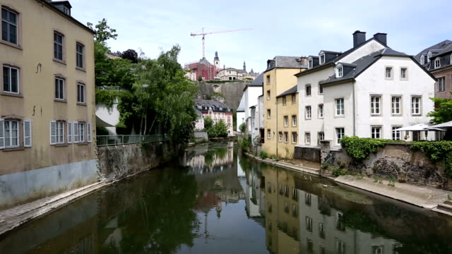 film tilt: luxembourg city grund old town cityscape - crane shot stock videos and b-roll footage