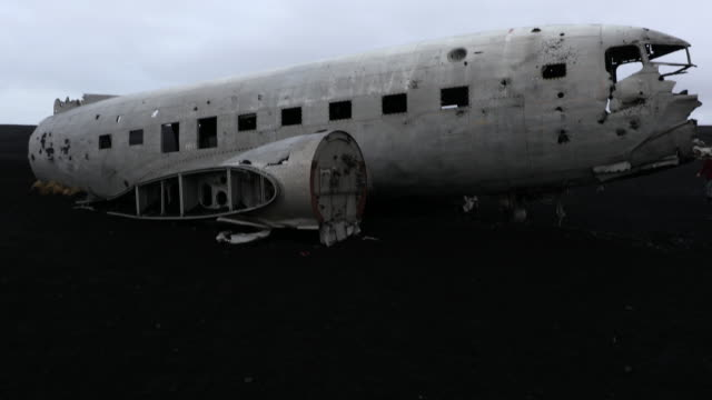 film tilt of  plane wreck on solheimasandur beach near vik, southern iceland - airplane crash stock videos and b-roll footage