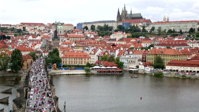 film tilt pedestrian crowded charles bridge karluv most czech republic - charles bridge stock videos and b-roll footage