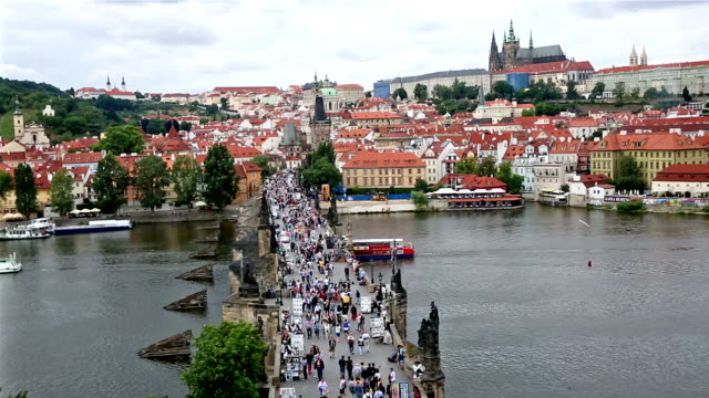 film tilt pedestrian crowded charles bridge karluv most czech republic - traditionally czech stock videos & royalty-free footage