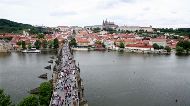 film tilt pedestrian crowded charles bridge karluv most czech republic - mala strana stock videos and b-roll footage