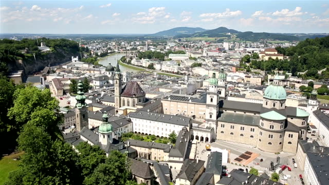 film tilt: pedestrian crowded salzburg cityscape city square austria - vienna stock videos & royalty-free footage