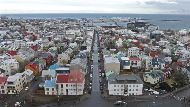 film tilt: rekjavik cityscape from hallgrimskirkja cathedral reykjavik iceland - reykjavik stock videos and b-roll footage