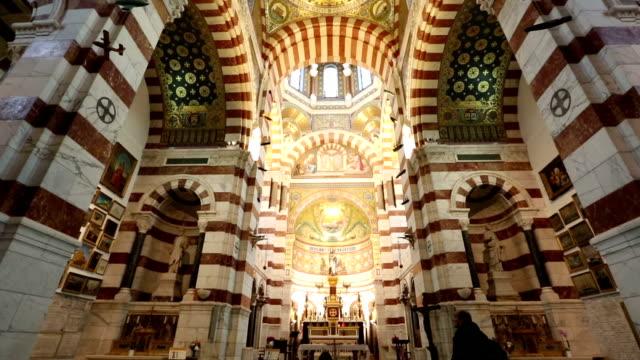 film tilt shot of marseille notre-dame de la garde church provence france - notre dame de la garde marseille stock videos and b-roll footage