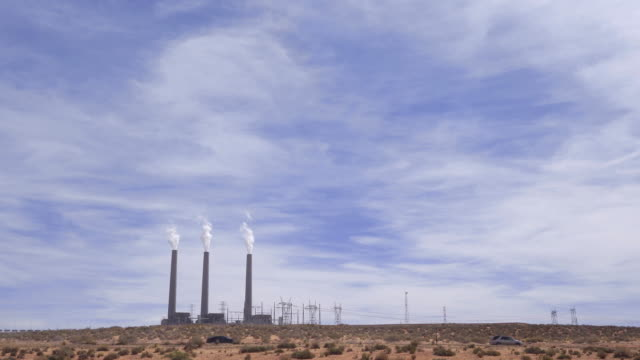 film tilt smoke from chimney tower of thermal coal power plant in page arizona usa - page arizona stock videos and b-roll footage