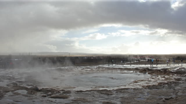 film tilt: tourist at strokkur geyser in iceland - volcanic crater stock videos & royalty-free footage