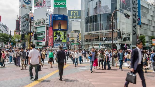 film tilt video of shibuya crossing in tokyo - shibuya ward stock videos & royalty-free footage