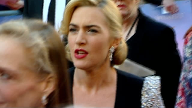 'titanic in 3d' premiere england london royal albert hall ext **music heard sot** kate winslet signing autographs on red carpet at 'titanic in 3d'... - kate winslet stock videos and b-roll footage
