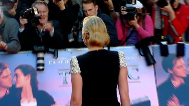 vidéos et rushes de titanic in 3d premiere: red carpet arrivals; england: london: royal albert hall: ext james cameron and wife suzy amis speaking to press / kate... - titanic