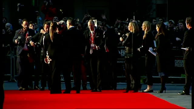 Tom Hanks gvs and interview ENGLAND London EXT Tom Hanks and wife Rita Wilson on red carpet surrounded by media and fans