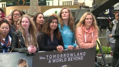 world beyond: european film premiere; england: london: ext fans and posters along red carpet at 'tomorrowland: a world beyond' film premiere / george... - hugh laurie stock videos & royalty-free footage