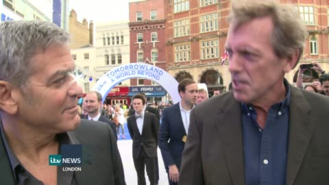 'tomorrowland' premiere; george clooney and hugh laurie interview on red carpet sot - clooney jokes about following laurie on twitter - hugh laurie stock videos & royalty-free footage