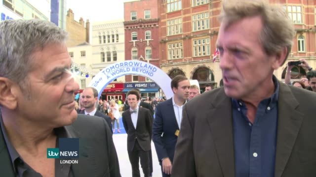 'Tomorrowland' premiere George Clooney and Hugh Laurie interview on red carpet SOT Clooney jokes about following Laurie on Twitter