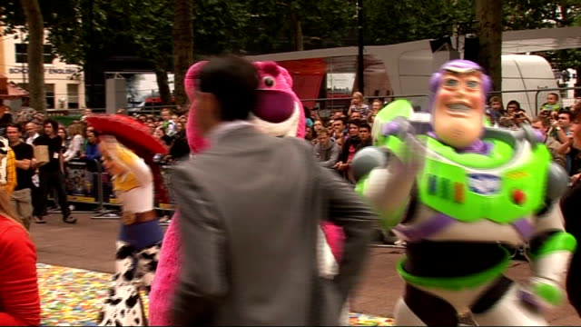 'Toy Story 3' premiere in London celebrity arrivals ENGLAND London Leicester Square EXT **Music heard SOT** Fans standing behind barrier with sign...