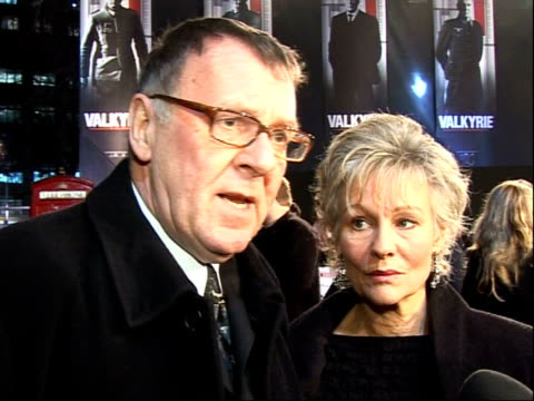 'valkyrie' premiere red carpet arrivals tom wilkinson interview sot introduces wife diana oscars are 5 times as big as the premiere packed with so... - tom wilkinson actor stock videos & royalty-free footage